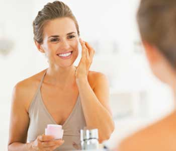 Apply rich moisturizer from dermatologist in Huntington, NY