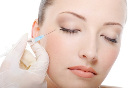 woman face being injected with botox