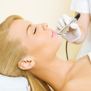 Woman having microdermabrasion treatment