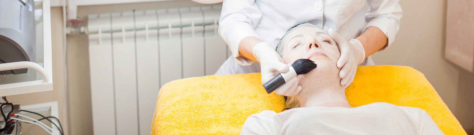 Woman taking procedures in beauty parlor