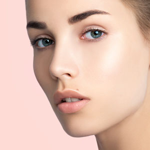 Beautiful young woman's face with clean, perfect skin