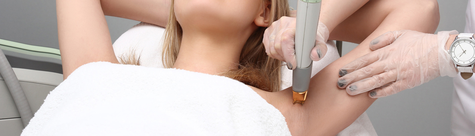 Woman having underarm Laser hair removal