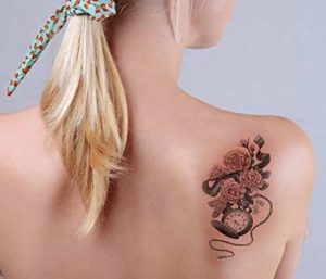 Woman with tattoo on her back
