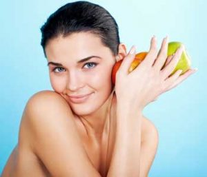 Attractive woman holding apple in her hand